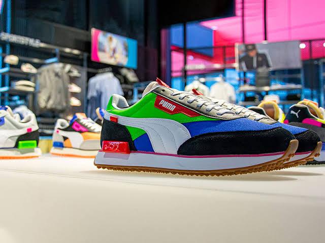 Puma Shoes in a showroom   Marketing Mix of Puma   IIDE